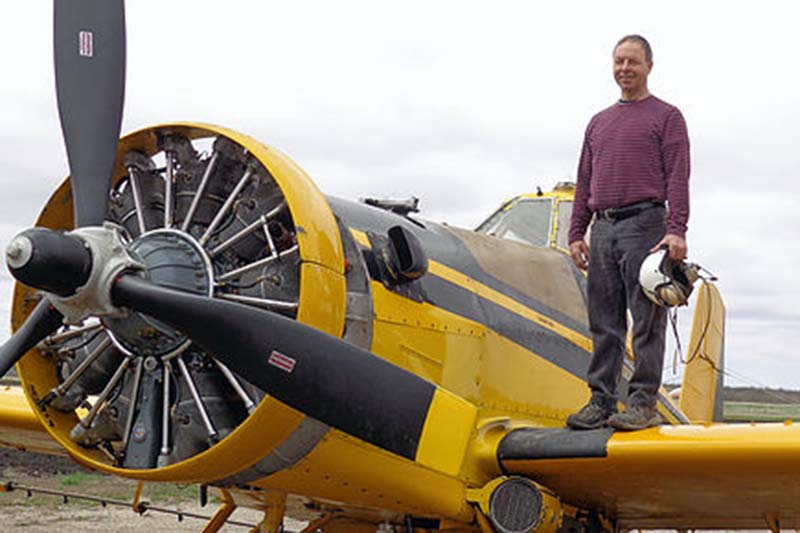 photo shows Baldur MB pilot Harold Parsonage with his Ayres Thrush crop spraying plane (photo Air Greenway)