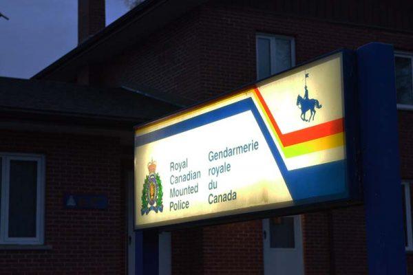 photo shows RCMP sign illuminated at night (photo Glen Kirby)