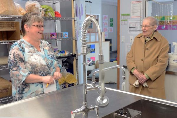 photo shows Souris daycare founding member Jean Dornian (r) talking with current director Brenda Morris in the newly renovated kitchen (photo Glen Kirby)