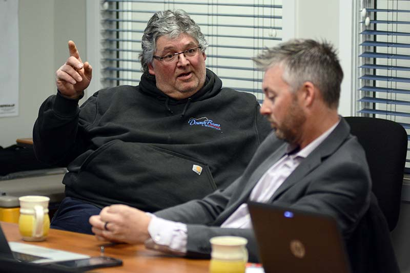 photo shows trustees Allan Downey and Scott Perkin debating the 2018-2019 Southwest Horizon schools budget (photo Glen Kirby)