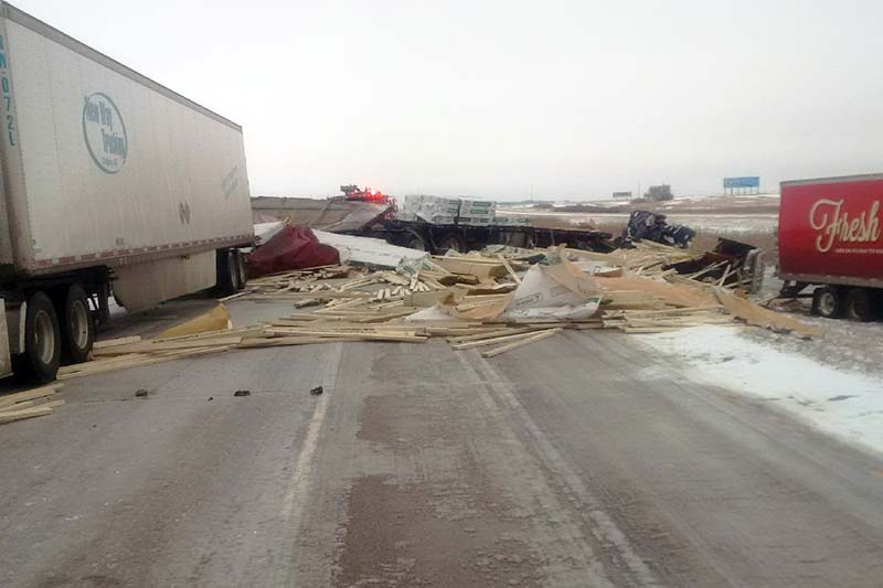 photo shows debris along the Trans-Canada Highway after several semis collided near Alexander (photo RCMP)