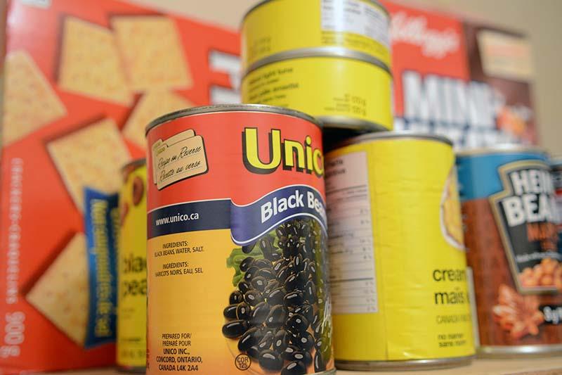 photo shows stacks of non-perishable food (photo Glen Kirby)
