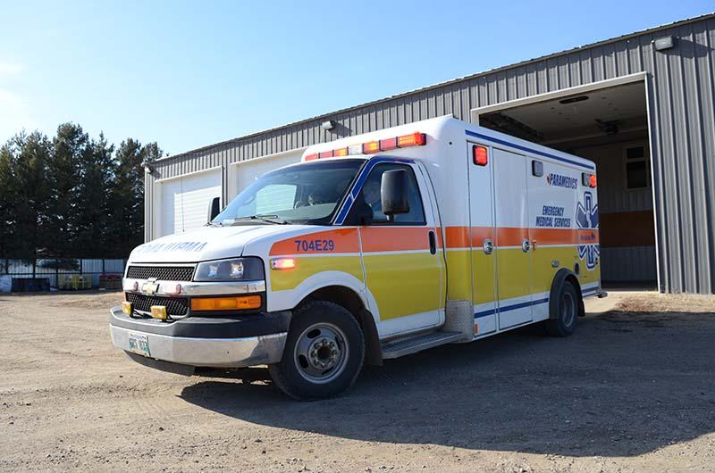 photo shows Sifton ambulance leaving garage in Oak Lake MB (photo Glen Kirby)